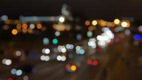 Blur background. Moving bokeh circles of night traffic. Defocused night traffic lights at Ratchaprasong Intersection. Bangkok, Thailand. Moving particles stock video