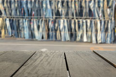 Blur background of terrace wood and Jean shop in market Stock Image
