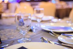 Wine glasses are arranged high in the party. Blur background, Wine glasses, cutlery plates are beautifully placed on the dining table royalty free stock photography