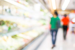 Blur background of woman customer select fresh product on shelf Stock Images