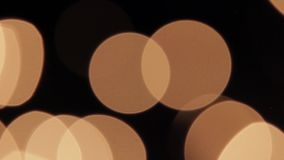 Blurring of gold lights on black background HD. Blur balls of gold on black background HD 1920x1080 stock footage