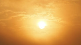 Blur beautiful sun and orange sky. Sunset sunrise in background. Abstract orange sky. Dramatic golden sky at the sunset background Stock Photo