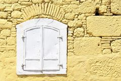 White shutters and old yellow walls from Pergamon antique city, Turkey. Blur blue shutter shutters old red walls pergamon antique city turkey rough history stock image