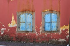 Blue shutters and old red walls from Pergamon antique city, Turkey. Blur blue shutter shutters old red walls pergamon antique city turkey rough history tourism stock photography
