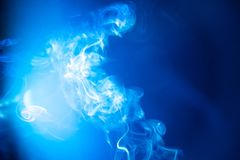 Blur blue smoke abstract texture background and light glowing royalty free stock photos
