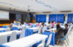 Blur blurred abstract at Business education training. Conference hall or room seminar meeting People Analyzing Statistics Financial Concept with attendee Stock Photos