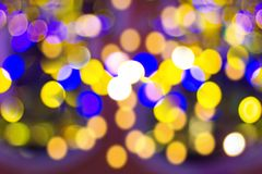 Blur - bokeh Decorative outdoor string lights hanging on tree in the garden at night time stock photography