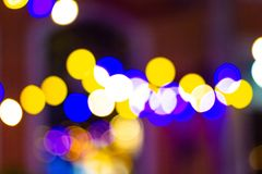 Blur - bokeh Decorative outdoor string lights hanging on tree in the garden royalty free stock photography