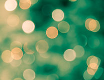 Blur bokeh defocused of light in green and yellow background Stock Images