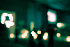 Blur bokeh of indoor party in dark room Royalty Free Stock Image