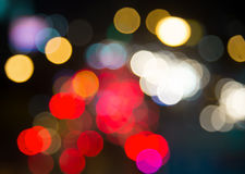 Blur bokeh traffic light  in urban at night scene Royalty Free Stock Photos