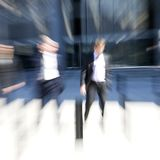 Blur of businessmen Stock Photo