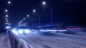 Blur of car traffic at night in the snow. Blur of car traffic at night in a snowfall in blue Royalty Free Stock Image