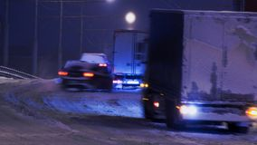 Blur of car traffic at night in the snow. Blur of car traffic at night in a snowfall in blue Royalty Free Stock Photo