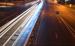 Blur cars driving at night. In downtown, light trails Royalty Free Stock Image