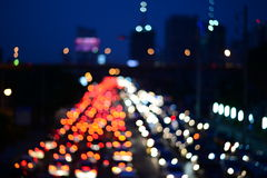Blur cars traffic on urban street red and white bokeh Stock Photos