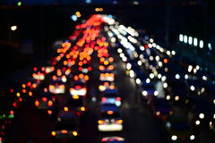 Blur cars traffic on urban street red and white bokeh Stock Images