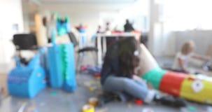 Child cutting paper in class blur. Blur: Child cutting paper in class. Kids development and social lerning children in art school. Children`s project stock video