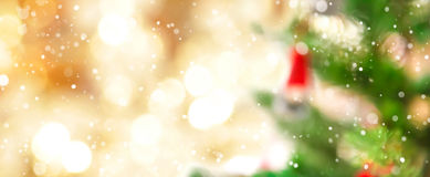 Blur Christmas tree and gold bokeh with snow stock photography