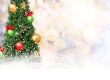 Blur christmas tree and gold bokeh with snowflake. Stock Photo