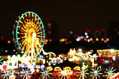 Blur colors light beam of fluorescent light colorful in ferris wheel festival temple fair night background, lighting beam stock photos