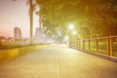 Blur concrete way in park to exercise and relax on warm morning time Stock Photography