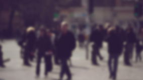 Blur Crowd of People Walking On the Street in Bokeh, unrecognizable group of men and women as blur urban background stock footage