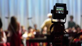 Blur dancer and orchestra on the stage with tv camera. Blur dancer and orchestra on the stage with camerman forground stock video