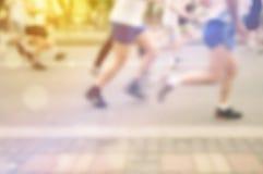 Blur Defocus People Running Marathon. Blurred Defocus Sport Background Image with Unrecgonizable People Running Marathon on the Street Royalty Free Stock Images
