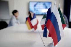 Blur effect. Meeting of management, meeting of directors. International commission, table with flags of EU, Russia and other count royalty free stock image