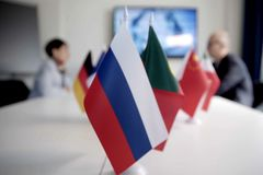 Blur effect. Meeting of management, meeting of directors. International commission, table with flags of EU, Russia and other count royalty free stock photography