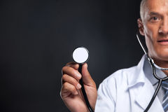 Blur face on background. Close up of stethoscope in doctor's hand stock images