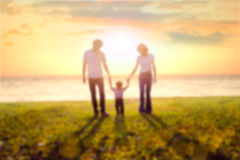 Blur Family on beach. At sunset Stock Images