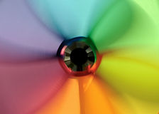 The blur of a fast moving spinning wheel Stock Images