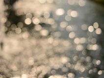 Blur flow water sparkle with white bokeh  background Royalty Free Stock Photo