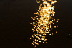 Blur gold bokeh in dark. Night background Royalty Free Stock Photography
