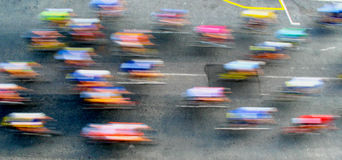 The blur of a high-speed pelaton during a cycle race Stock Image
