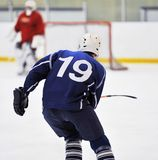 Blur hockey player's. Ice hockey player handling puck and skating forward Stock Images