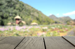 Blur image of Agriculture terrace wood and beautiful garden. Defocused and blur image of Agriculture terrace wood and beautiful meadow for background usage Royalty Free Stock Photography