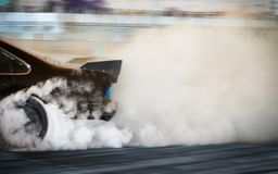 Blur image of car drifting on race track stock image