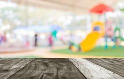 Blur image of children's playground at public park . Stock Photos