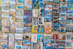 Blur image of greeting travel colourful postcards on display in Royalty Free Stock Photos