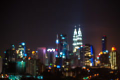 Blur image of Kuala Lumpur city, star bokeh shape Royalty Free Stock Photo