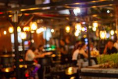 Blur image Lots of people enjoy the fun of night festival in a restaurant. Abstract blur image Lots of people enjoy the fun of night festival in a restaurant and royalty free stock photo