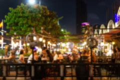 Blur image Lots of people enjoy the fun of night festival in a restaurant and The atmosphere. Abstract blur image Lots of people enjoy the fun of night festival stock photography