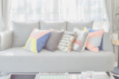 Blur image of modern living room design with colorful pillows on sofa Stock Photo