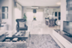 Blur image of modern living room interior with dining table and pantry. At home stock photos