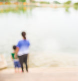 Blur image of people on lakeside for background usage Royalty Free Stock Images