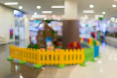 Blur image of playground in the mall use for background.  Stock Photography