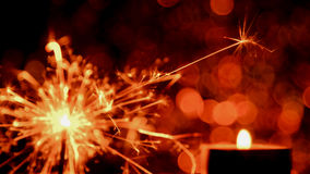 Blur image style. Christmas and New Year party sparkler and Candle flame light Stock Photography
